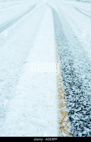 Snowy road, close-up - Stock Image