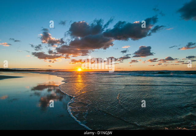 Sunset at Flinders Beach, North Stradbroke Island, Queensland, Australia - Stock Image