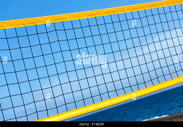 Volleyball net on the beach close up. - Stock Image