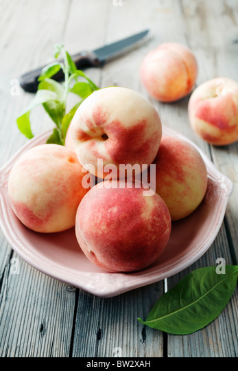 bowl of fresh peaches - Stock Image