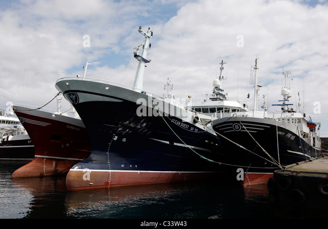 Bow fishing boat quayside in stock photos bow fishing for Large fishing boats