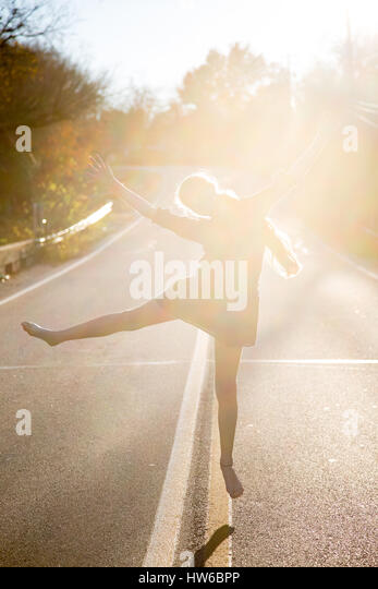 Girl jumping for joy - Stock Image