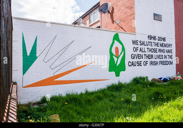 Belfast mural in commemoration of those who have given their lives in the cause of Irish Freedom from 1916 to 2016. - Stock Image