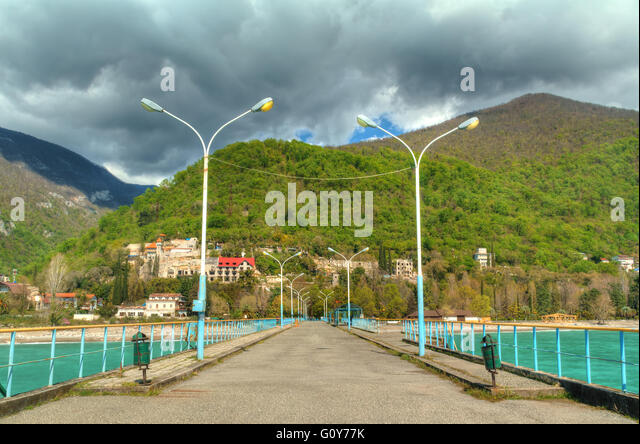 View of mountains from walkway on pier in Gagra, Abkhazia, HDR processing - Stock Image