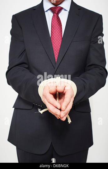 Businessman with hands tied - Stock Image