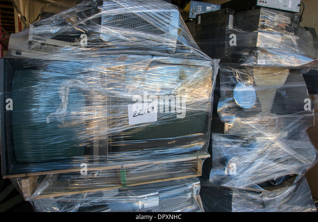 Computers and office equipment gathered at a recycling center before shipping to a processibg facility. - Stock Image