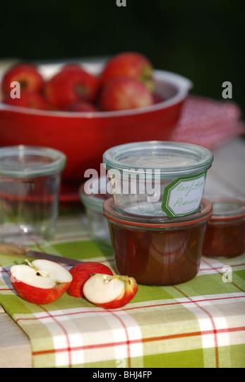 Apples and jam jars - Stock Image