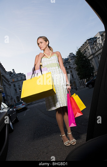 Woman carrying shopping bags - Stock Image