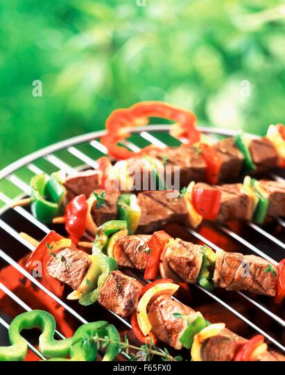 Kebabs on barbecue - Stock Image