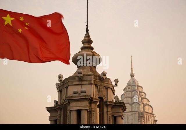 China, Shanghai, The Bund, Chinese flag - Stock Image