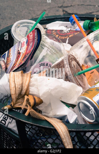 Trash can on an urban street, NYC - Stock Image