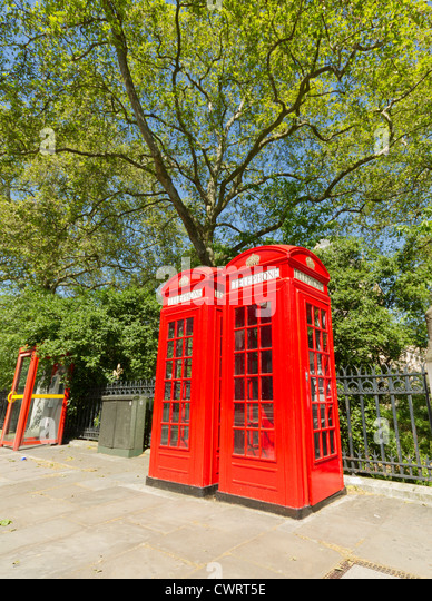 Contrasting London Phone Boxes - Stock Image