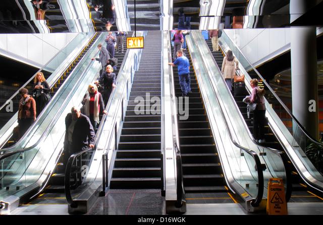 Chicago Illinois O'Hare International Airport ORD concourse escalator passengers - Stock Image