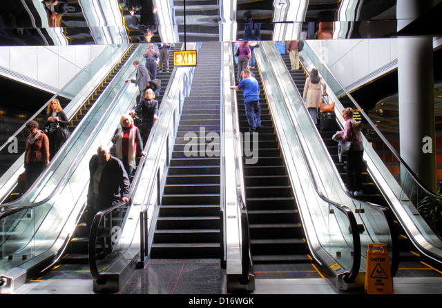 Illinois Chicago O'Hare International Airport ORD concourse escalator passengers - Stock Image