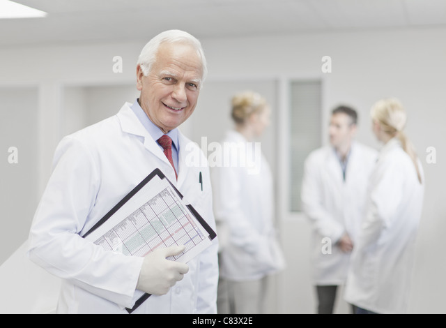 Scientist with notes in pathology lab - Stock Image
