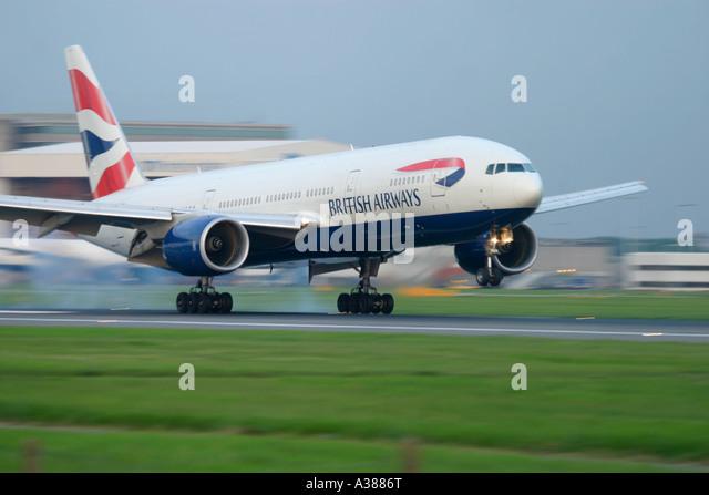 British Airways Boeing 777 touching down with smoke at London Heathrow Airport UK - Stock Image