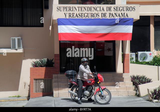 Panama Panama City Bella Vista government agency building insurance superintendent regulators man riding motorcycle - Stock Image