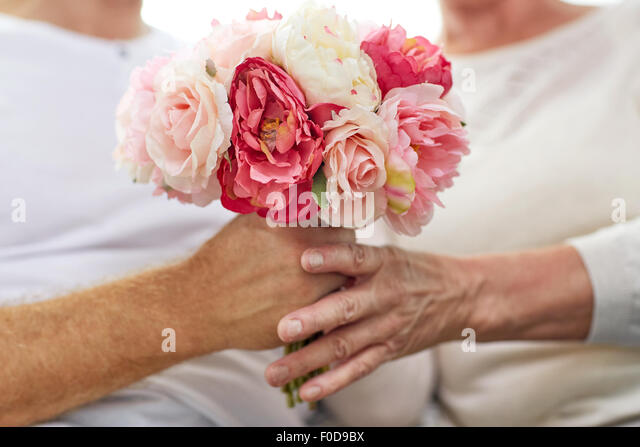 close up of senior couple with flowers - Stock-Bilder