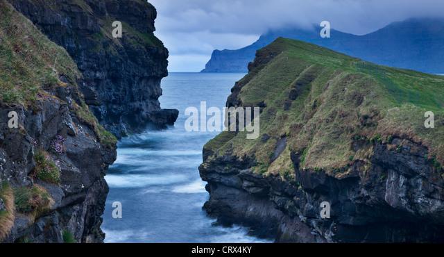 Dramatic coastline at Gjogv on the island of Eysturoy, Faroe Islands. Spring (June) 2012. - Stock Image