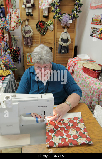Plant City Florida Florida Strawberry Festival annual event senior woman sewing machine arts and & crafts for - Stock Image