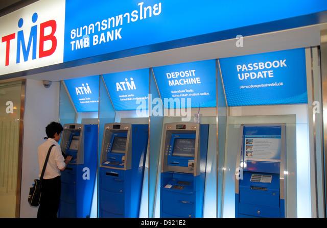 Bangkok Thailand Pathum Wan Rama 1 Road MBK Center centre complex mall shopping ATM banking TMB Bank self service - Stock Image