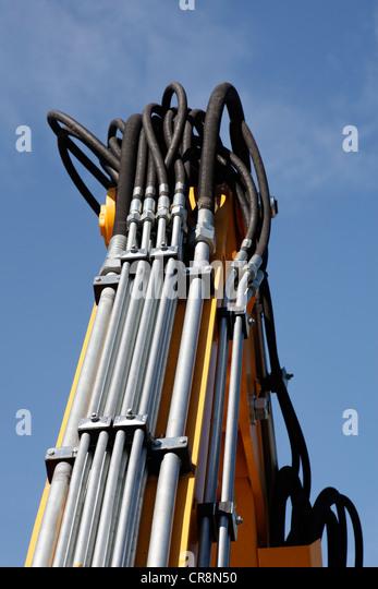 Pressure pipes and hoses of a hydraulic machine, Rheinhafen Krefeld, North Rhine-Westphalia, Germany, Europe - Stock Image
