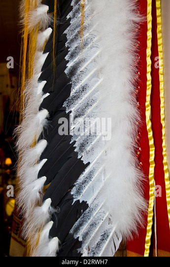 Closeup detail of Native American Navajo Indian chief headdress made of real feathers, tourist souvenir Rapid City - Stock Image