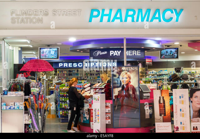 Melbourne Australia Victoria Central Business District CBD Flinders Street Station pharmacy drugstore front entrance - Stock Image