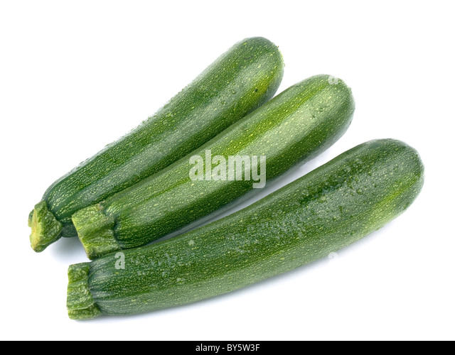 Fresh green zucchini on white background - Stock Image
