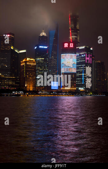 Skyline of the Pudong District viewed from the Bund across the Huangpu River in Shanghai, China - Stock Image