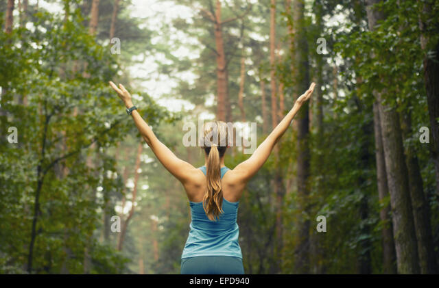 healthy lifestyle fitness sporty woman running early in the morning in forest area, fitness healthy lifestyle concept - Stock-Bilder