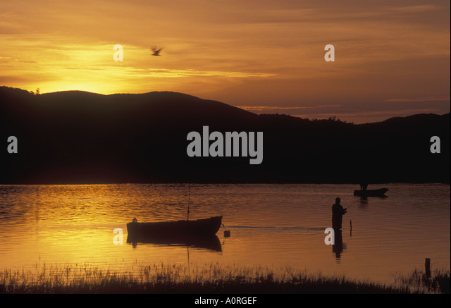 Fisherman at dawn angling in Knysna Lagoon on the Garden Route Cape Province South Africa - Stock Image