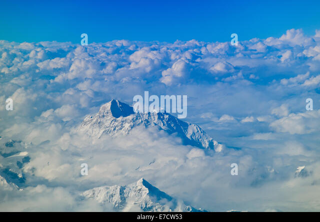 Views of Mount Everest (Highest Peek) and Himalayas through Clouds on Journey with Druk Airlines between Bhutan - Stock Image