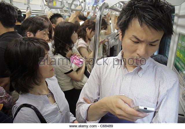 Japan Tokyo Shibuya JR Shibuya Station train subway Yamanote Line car passengers commuters crowded packed standing - Stock Image
