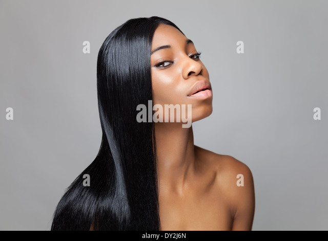 Young black beauty with long hair - Stock-Bilder