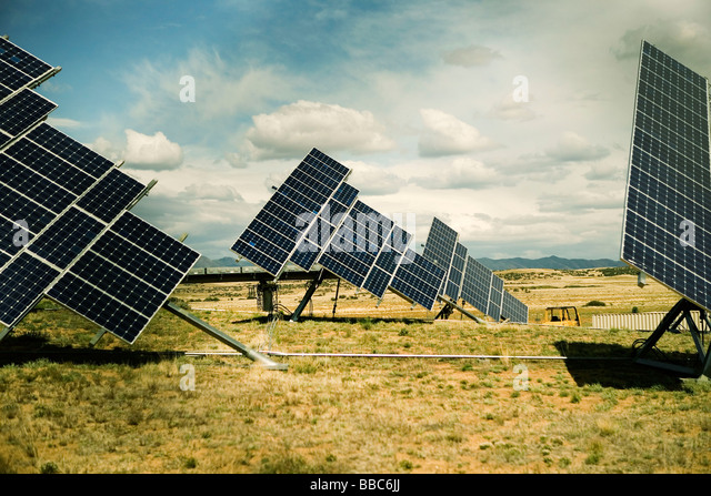 Photovoltaic arrays tilted to sun - Stock Image