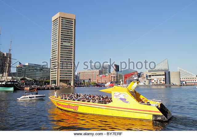Maryland Baltimore Inner Harbor Harborplace Patapsco River waterfront World Trade Center skyline Seadog Speedboat - Stock Image