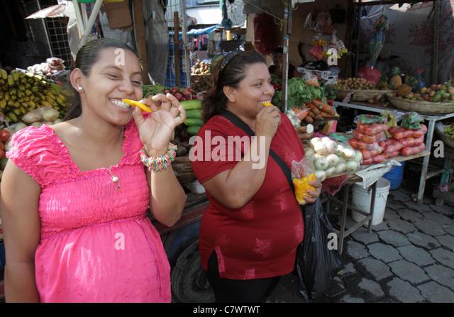Managua Nicaragua Mercado Oriental flea market marketplace shopping produce stand vegetables fruit vendor merchant - Stock Image