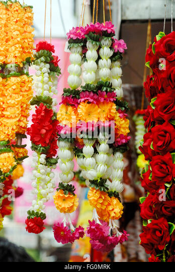 Artificial colourful flowers stock photos artificial for Artificial flower decoration for ganpati