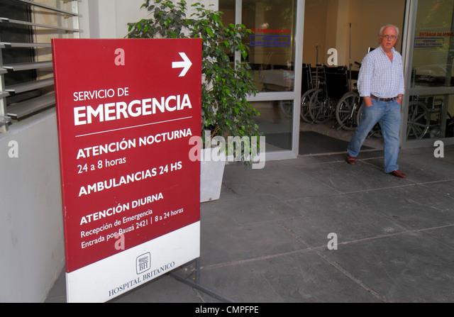 Uruguay Montevideo Hospital Britanico Avenida Italia Hispanic man sign emergency room entrance health care medical - Stock Image