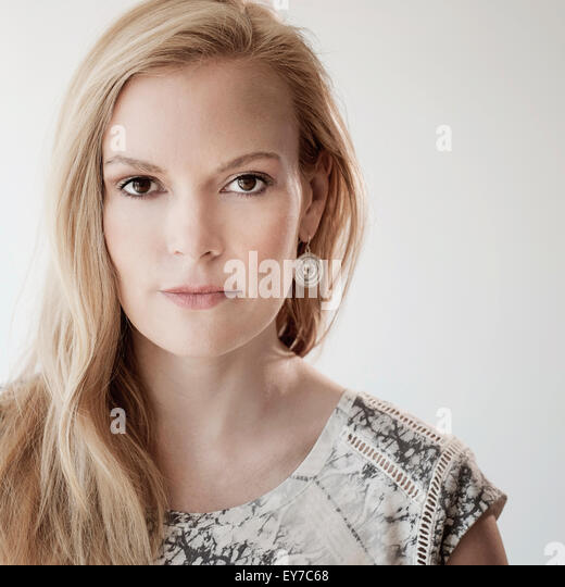 Portrait of mid-adult woman on white background - Stock Image