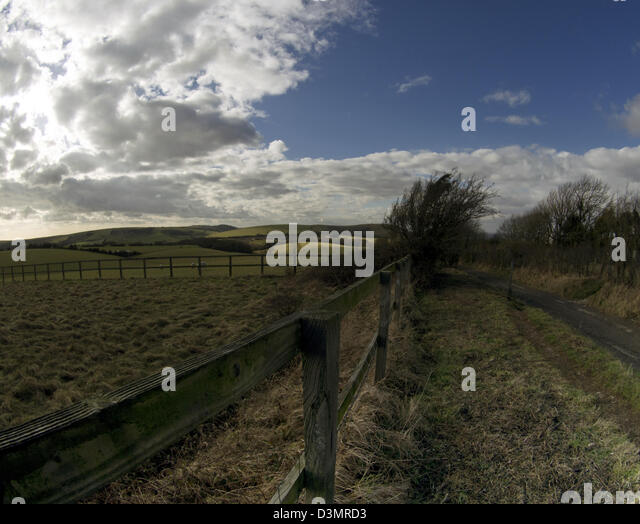South Downs National Park road that leads to Jack and Jill windmills near Clayton, Sussex, UK - Stock Image