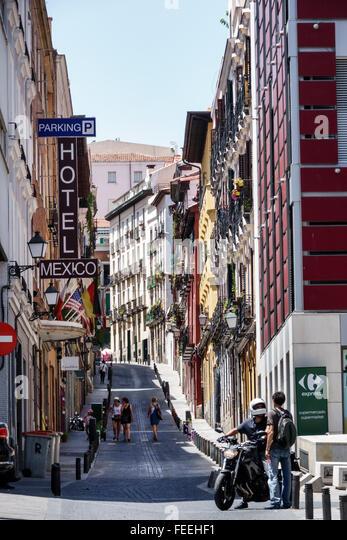 Madrid Spain Europe Spanish Hispanic Centro Calle Gobernador narrow street buildings apartment - Stock Image