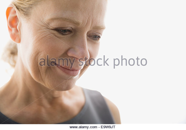 Close up portrait of smiling woman looking down - Stock Image
