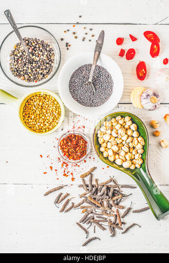 Spices of Middle East , Caucasian and Asian cuisine on the white table vertical - Stock Image
