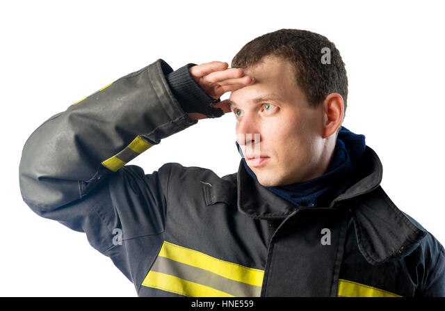 Fireman in protective suit looks off into the distance on a white background - Stock Image