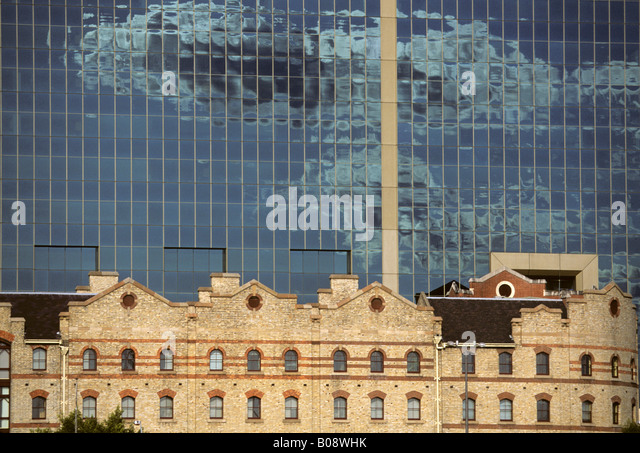 Old harbour building in front of modern glass office building, Darling Harbour, Sydney, New South Wales, Australia - Stock Image