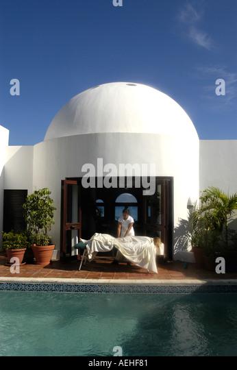 Anguilla Cap Juluca Guest Receiving Outdoor Massage  Beside Villa  Pool - Stock Image