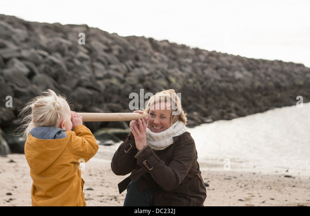 Grandmother and toddler having fun at coast - Stock Image