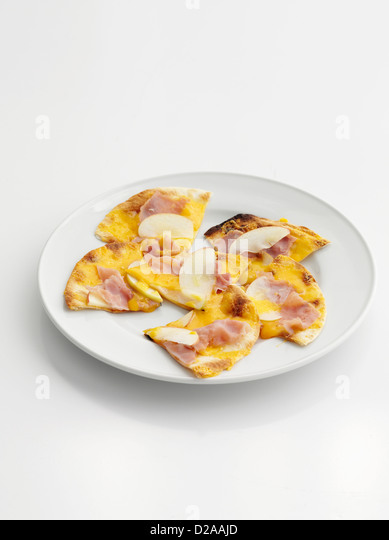 Plate of ham and cheese flatbread - Stock Image